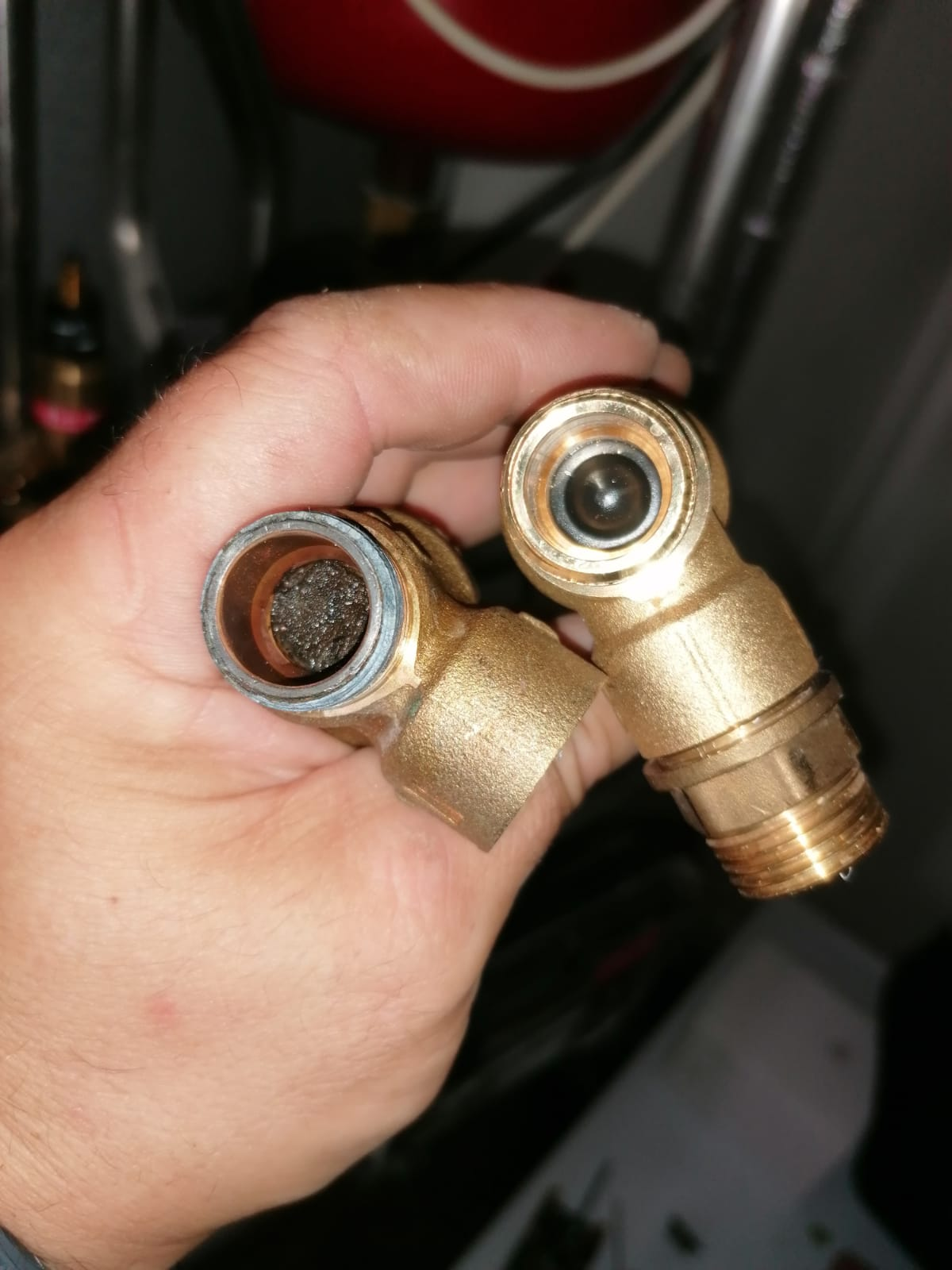 The valve on the left hand side is fully blocked by dirt. And caused overpressure in the system and the pressure relief valve started leaking.